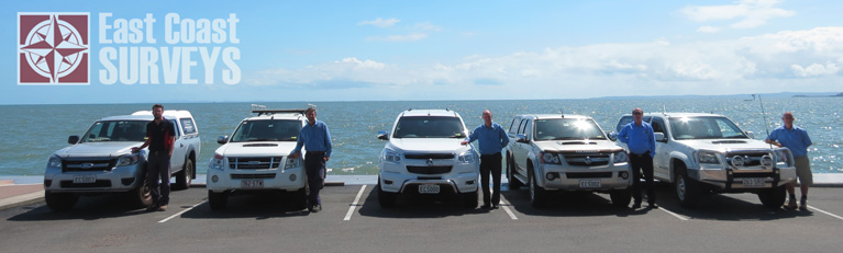 Our staff with cars at beach